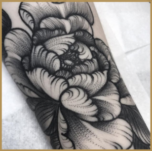 Black and grey flower tattoo by Owenzor