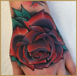Tattoo of a rose by Cesar Mesquita