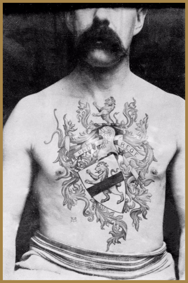 Black and white photo of a victorian man with a coat of arms chest tattoo