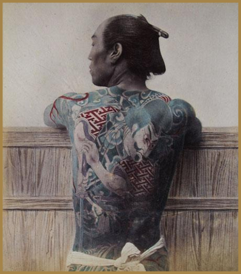 Old photo of a japanese man with large back tattoo